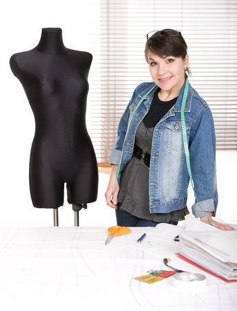 designer: young adult fashion designer at work Stock Photo