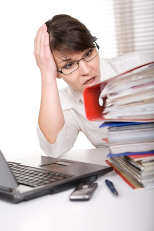 young adult over-worked woman at desk Stock Photo - 9076247