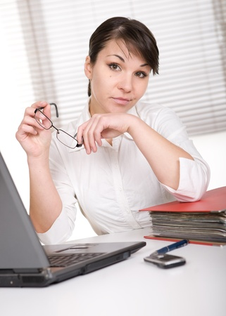 young adult over-worked woman at desk Stock Photo - 9076239