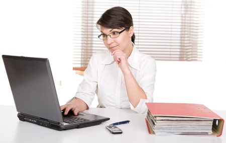 young adult over-worked woman at desk photo