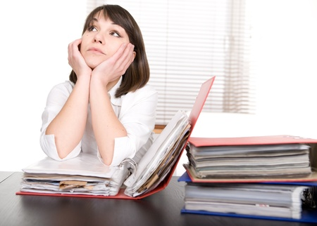young adult over-worked woman at desk Stock Photo - 9076237