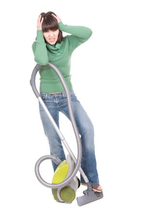young adult brunette woman with vacuum. over white background photo