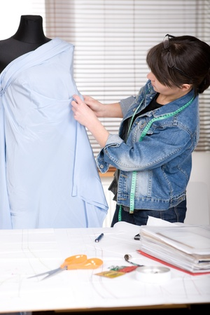 designer working: young adult fashion designer at work Stock Photo