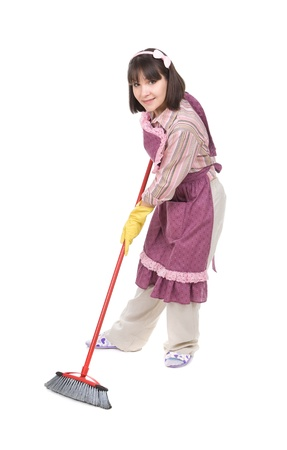 young adult woman doing housework over white background photo