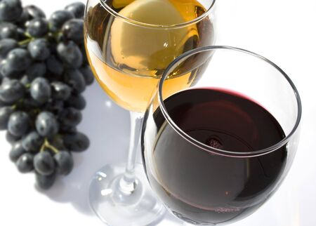 wineglasses: Two wineglasses with grapes Stock Photo