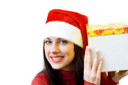 Pretty girl in Santa hat with the gift box Stock Photo - 3761087