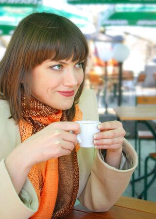 Young lady with a cup of espresso in the outdoor cafe Stock Photo - 4600361