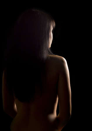 Nude female silhouette on black background