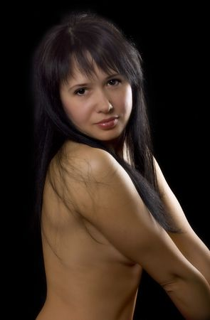 Nude young woman on black background Stock Photo