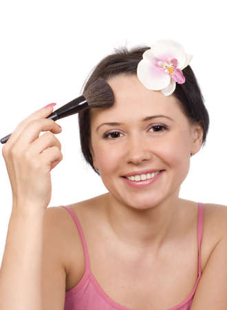 Young woman applying powder on her face Stock Photo - 4743189