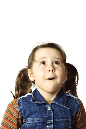 Cute little girl looking up with surprise on white Stock Photo - 4784782
