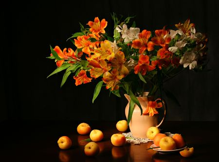 Biautiful flowers and apricots Stock Photo