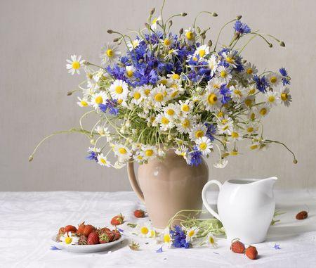 Strawberries and wild flowers photo