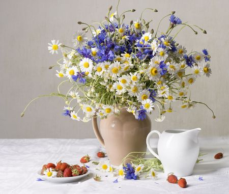 Strawberries and wild flowers photo