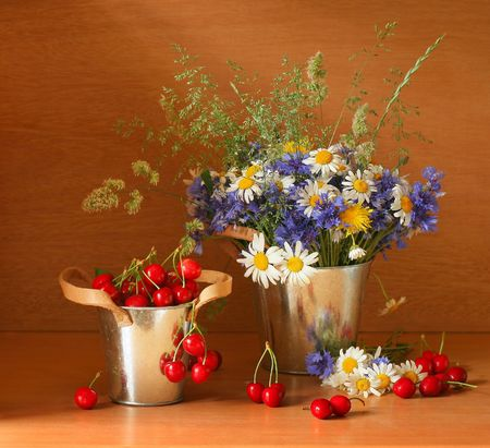 Beautiful stillife with cherries and fresh flowers photo