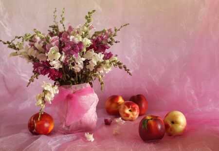 Beautiful still life with peaches and flowers Stock Photo