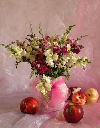 Still life with peaches and flowers photo
