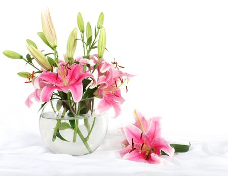 Bouquet of lilies on white background