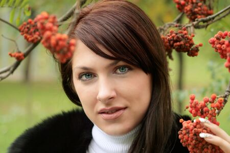 Portrait of young woman in the autumn park photo