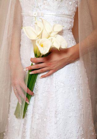 calas blancas: Elegante bouquet nupcial de callas blancos