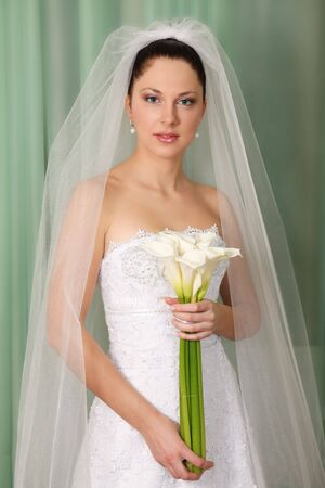 Beautiful bride with calla lillies bouquet Stock Photo