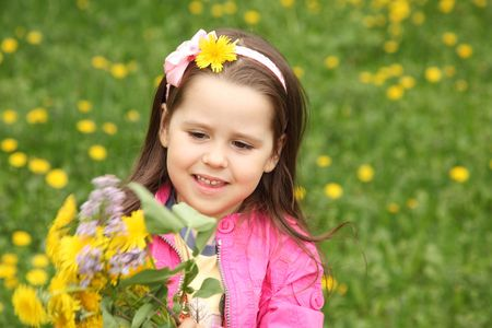 Happy little girl in the meadow with flowers Stock Photo - 7037046