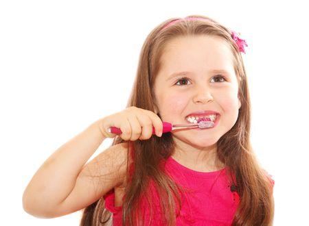Little girl cleaning teeth isolated on white photo