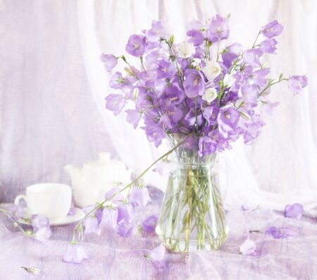 Beautiful still life with violet bell flowers photo