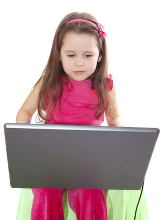 Cute little girl with the laptop Stock Photo - 8625911