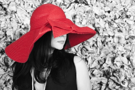 Young woman in red hat over the grunge background photo