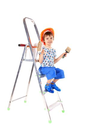 Little boy with paint brushes over the white background