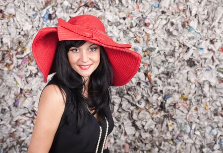 Young lady in red hat over the grunge background  photo