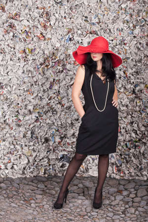 Beautiful lady in red hat over the grunge background photo