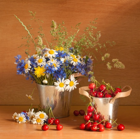 country life: Beautiful still life with cherries and fresh flowers  Stock Photo