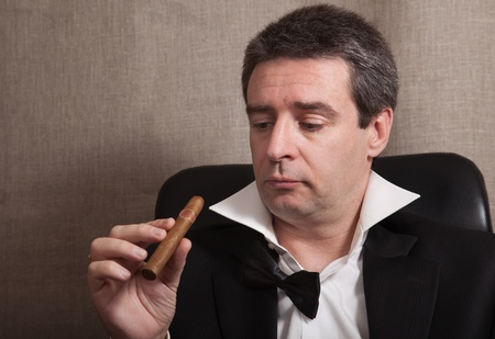 Picture of the relaxed man with a cigar photo