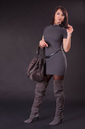 Beautiful young lady in high boots photo