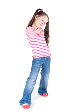 little girl in jeans pointing forward