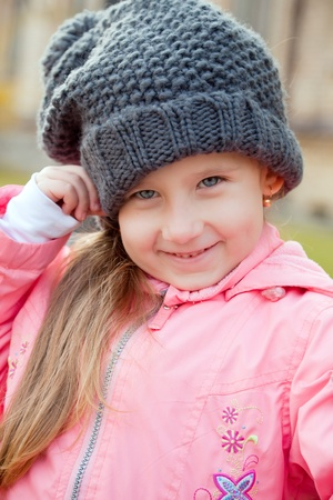 Cute little girl in wool warm hat photo
