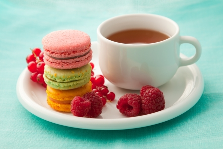Colorful macarons with a cup of tea photo