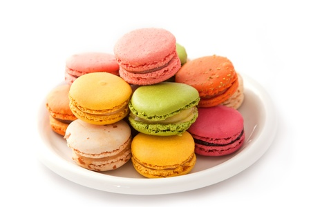 Colorful macarons on the white plate photo