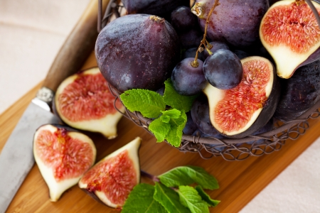 purple fig: Fresh figs and grapes with green mint leaves