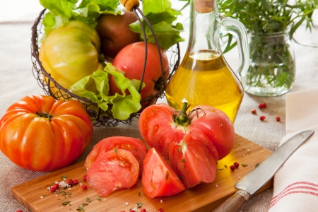 Ripe tomatoes with olive oil
