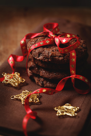 Christmas chocolate cookies tied with the ribbon photo