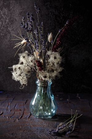 Still life with bouquet of dried flowers and herbs