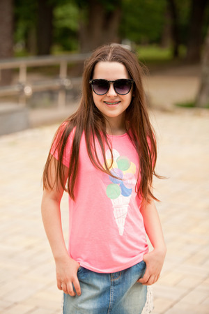 Happy stylish teenager girl in summer outfit photo
