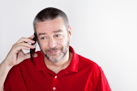 Mature man talking over the cell phone