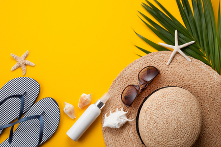 Summer vacation concept flat lay. Beach accessories top view. Space for text.