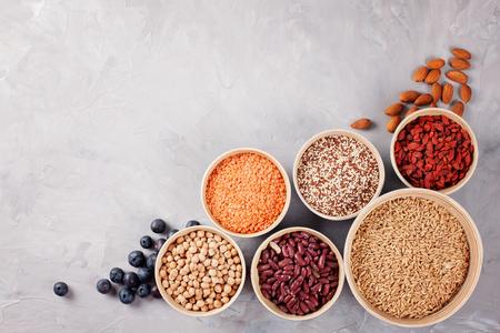 Various superfoods goji berries, quinoa, chia, hemp seeds, flax seeds, chickpeas, oats, almond, blueberries and lantils. Vegan, vegetarian healthy eating diet organic products concept Standard-Bild
