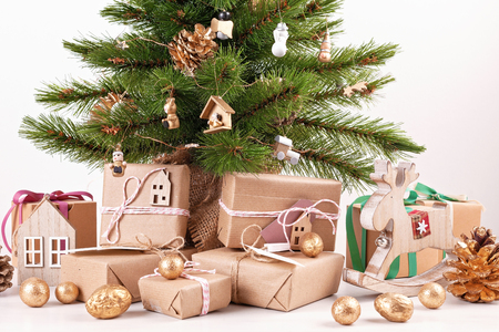 Beautiful decorated christmas tree with wrapped gifts. Christmas and new year celebration concept