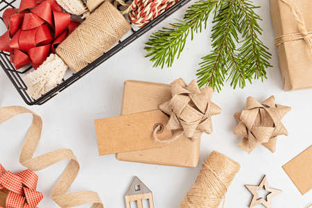 Eco friendly alternative green Xmas gifts wrapped with recycled craft paper. Zero waste Christmas, flat lay, top view